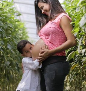 Pregnant woman with boy